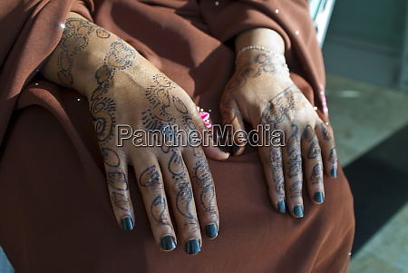 somali womans hands covered in henna