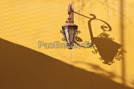 colonial lamp and bracket with shadow