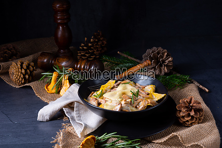 colorful farfalle pasta with chanterelles and