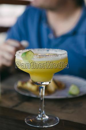 margarita with lime garnish