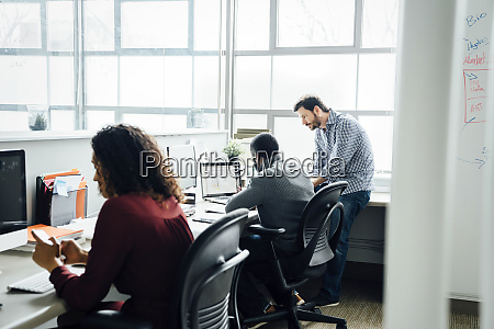 workers by window in office