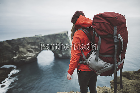 female hiker wearing red by natural