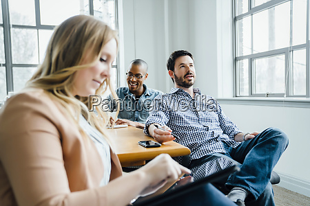 coworkers in board room during meeting
