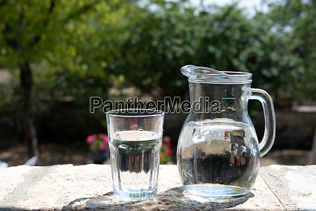 jug and glass of water outdoors