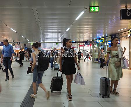 travellers in duesseldorf hauptbahnhof station