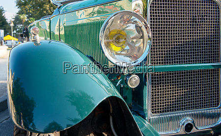 close up on headlight of antique