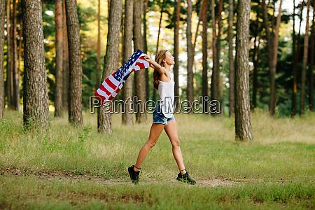 girl in denim shorts running with