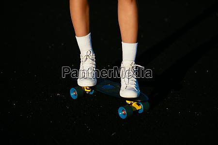 details ridding skateboard
