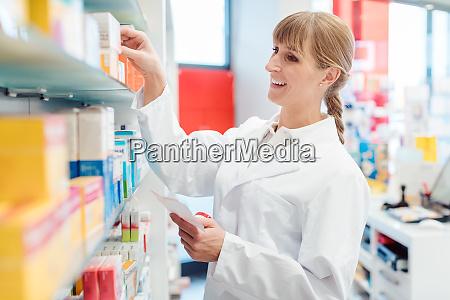 pharmacist or chemist woman sorting drugs