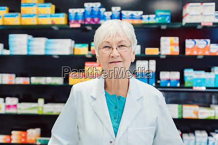 experienced senior pharmacists in front of