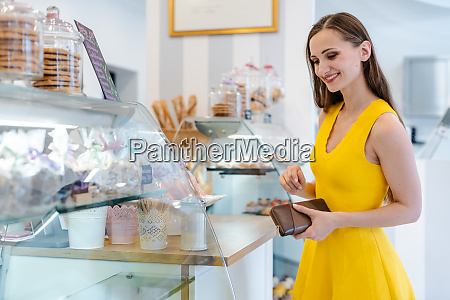 woman in the pastry shop choosing