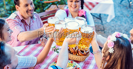 people enjoying food and drink in