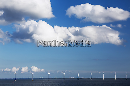 row of wind turbines in the