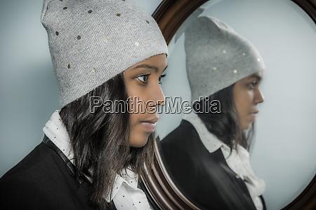 young hispanic woman wearing a knit