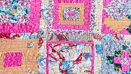 ornament of patchwork scarf stitched from