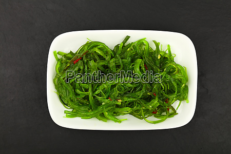 close up portion of green wakame