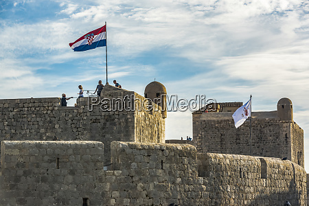 tourists on the walls of a