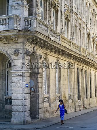a woman walks on the street