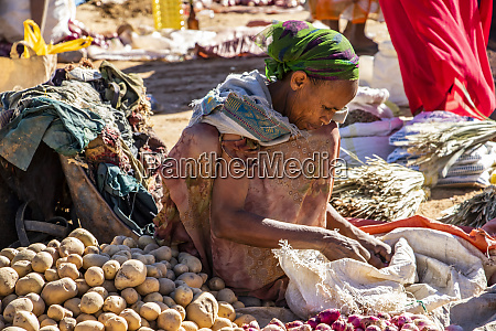 ethiopian woman selling potatoes at the