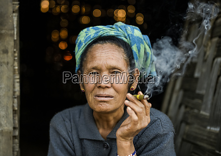 senior woman smoking a cheroot taungyii