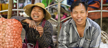man and woman sit laughing while