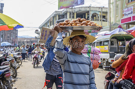 young man carrying food on his