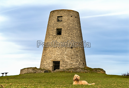 a round stone tower with a
