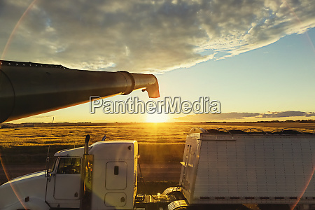 a grain truck at sunset is