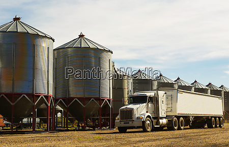 a grain truck parked in front