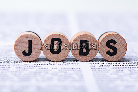 wooden blocks with jobs text over