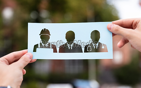 hands holding paper with cutout career