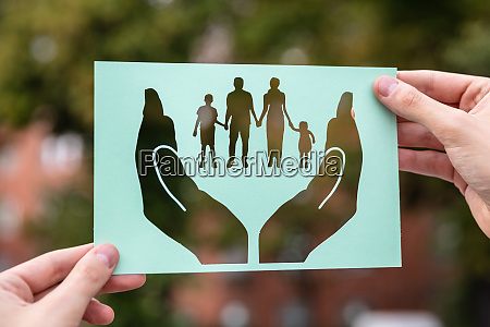 hands holding paper with cutout hands