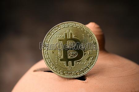 bitcoin symbol on piggy bank