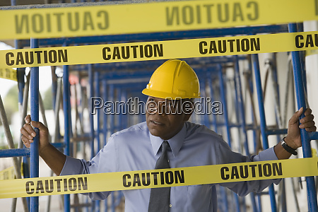 engineer holding scaffoldings