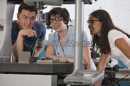 graduate assistant explaining the coordinate measuring
