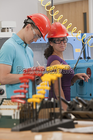 engineering students working in a cnc