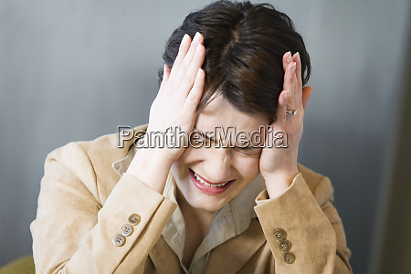 business woman crying in pain