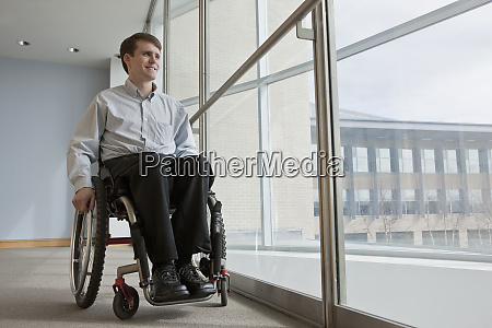businessman with spinal cord injury in