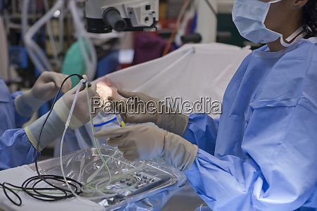 doctor passing phaco hand piece during
