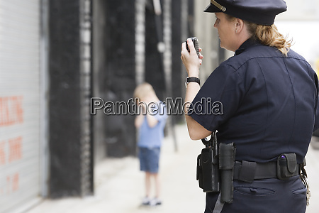 woman police officer talking on hand