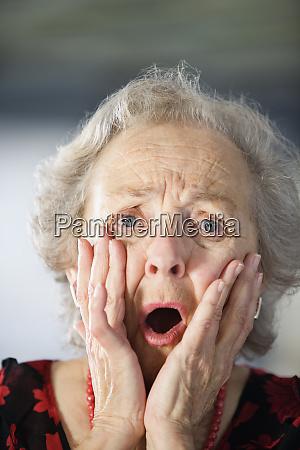 portrait of a shocked senior woman