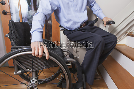 man with spinal cord injury getting