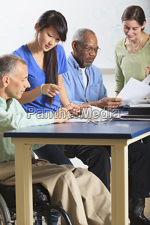 professors tutoring students one professor in