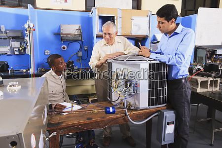 instructor training students about air conditioning