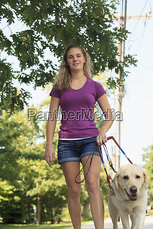 woman with visual impairment walking with
