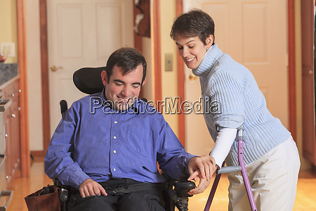 woman with cerebral palsy using crutches