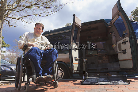 man with spinal cord injury opening