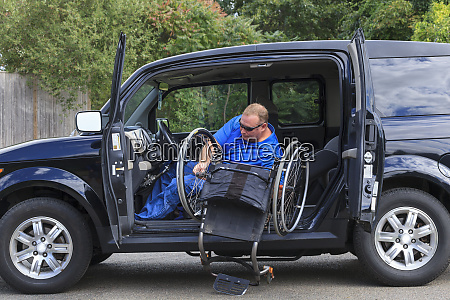man with spinal cord injury putting