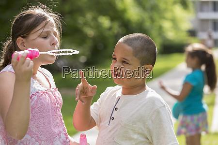 hispanic boy with autism playing outside