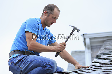 roofer with hearing aid on his